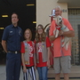 Bakersfield Girl Scouts meet dog Jack, after donating pet oxygen mask to fire stations