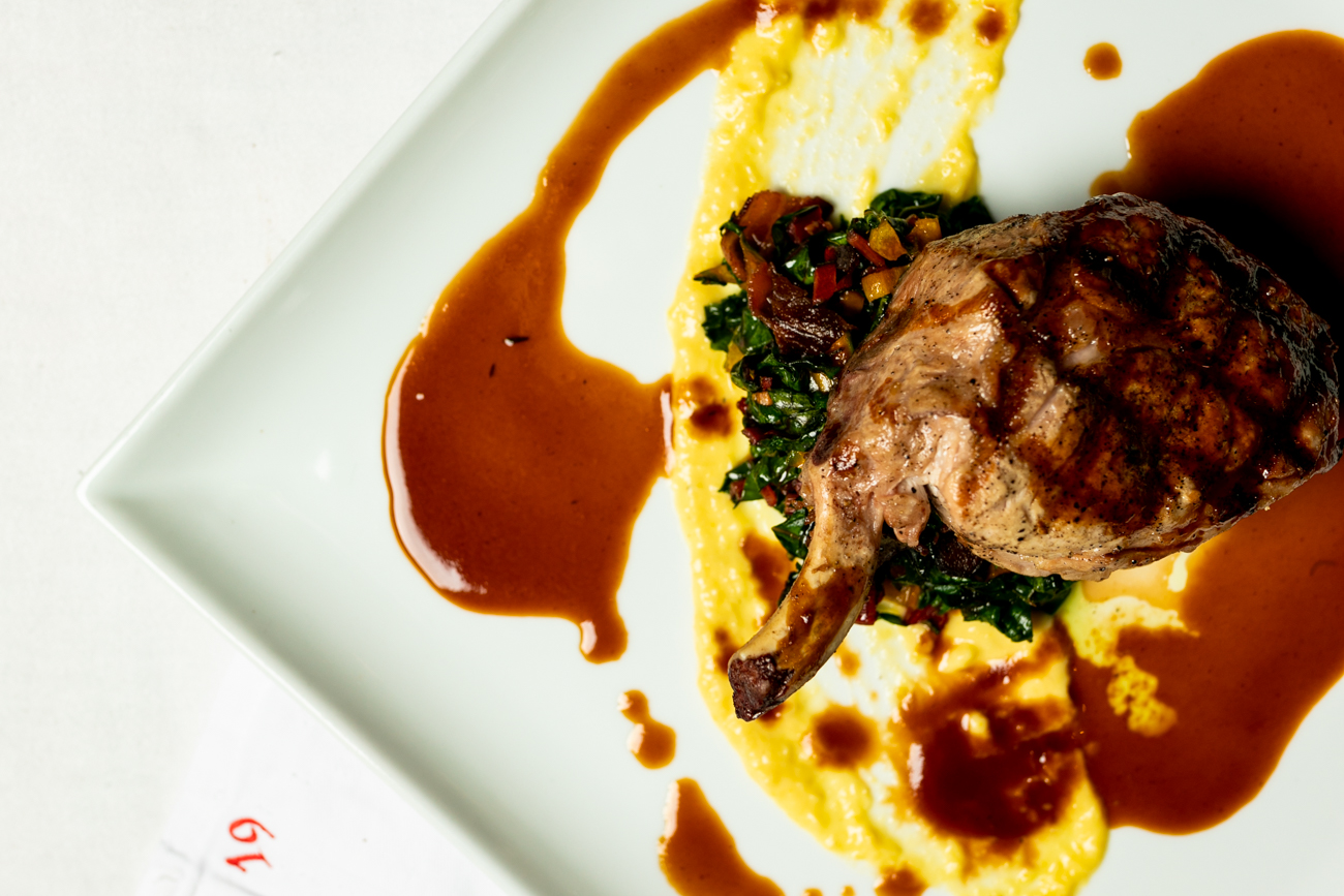 Marksberry Farm, Lancaster, Kentucky molasses-brined boneless pork rack: house-made farmer sausage, Belterra garden sweet corn puree, and Swiss chard / Image: Amy Elisabeth Spasoff // Published: 12.30.18