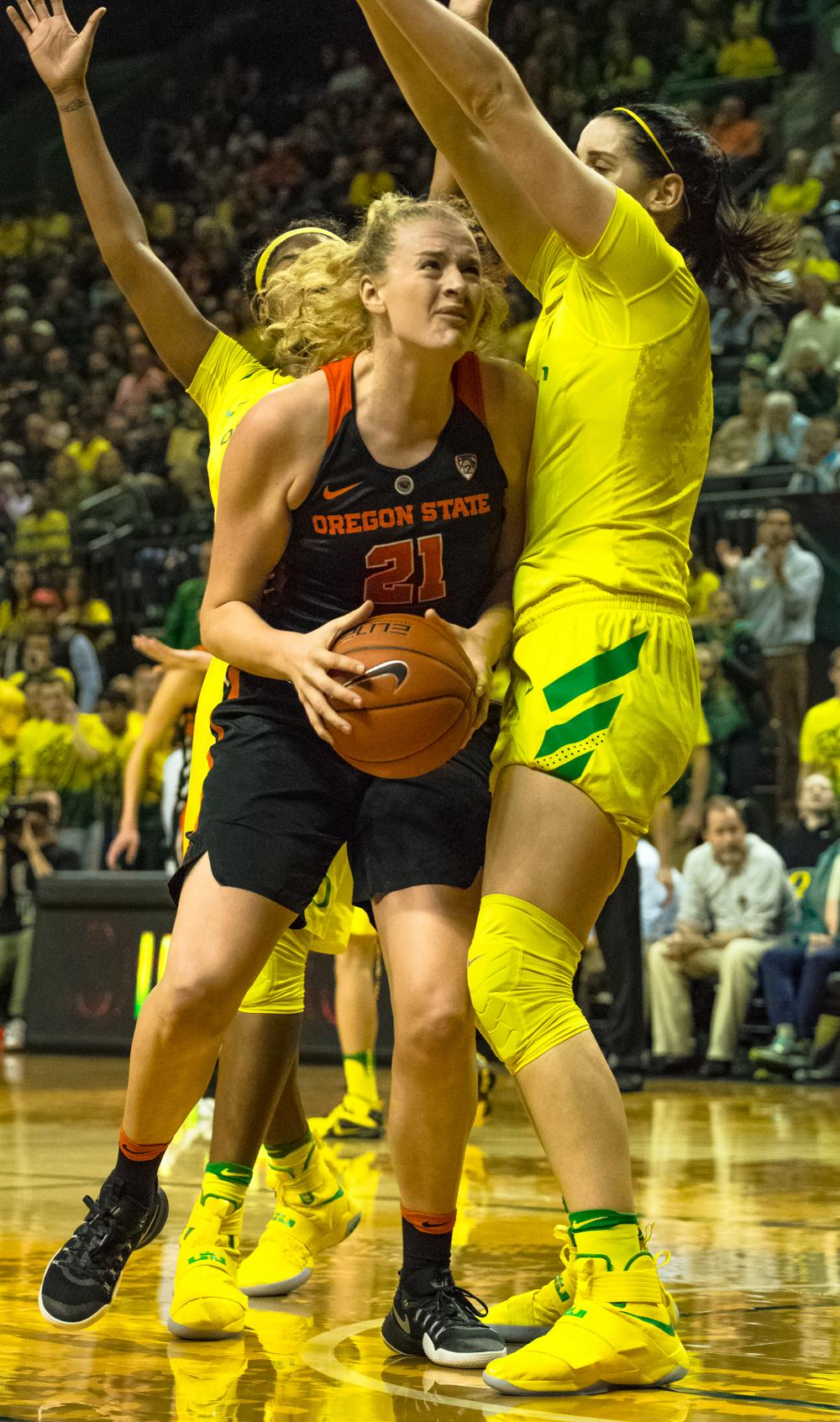Oregon Ducks Forward Jacinta Vadenberg (#15) protects the basket against Center Marie Gulich (#21) as she attempts a layup. Oregon Ducks lost 40-43 to Oregon State Beavers in a tightly matched fourth quarter. Photo by Jonathan Booker, Oregon News Lab