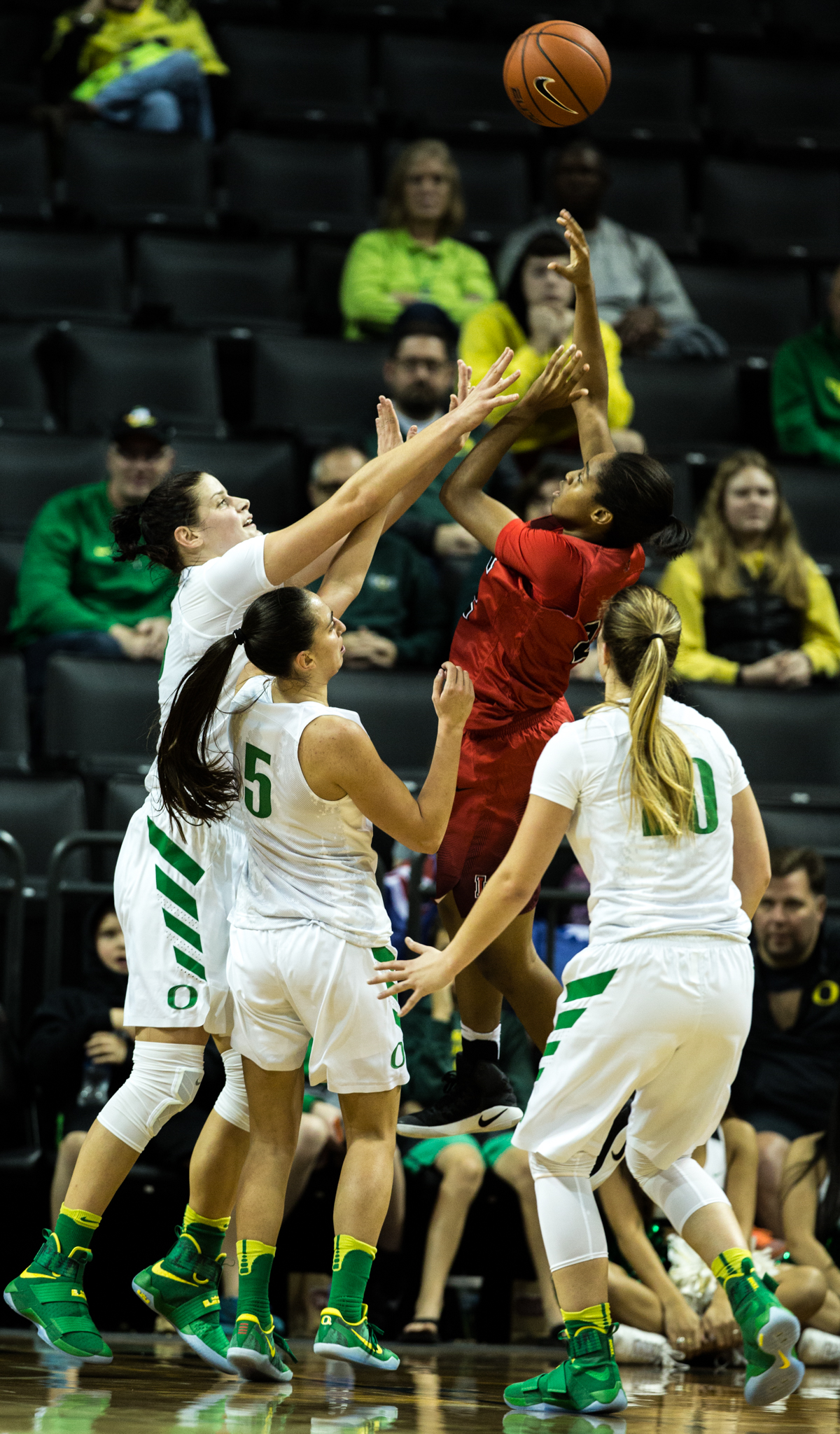 Lamar Cardinals guard DeA'ngela Mathis (#22) shoots over a trio of Oregon defenders. The Oregon Ducks Women's basketball team won their season opener against the Lamar Cardinals 84-67.  Photo by Austin Hicks, Oregon News Lab