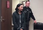 Naya Rivera in cuffs.JPG