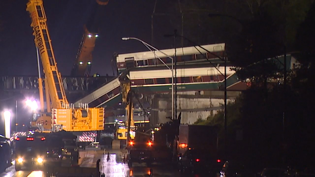 Crews work to clean up damaged rail cars after an Amtrak train derailed near Tacoma. (Photo: KOMO News)