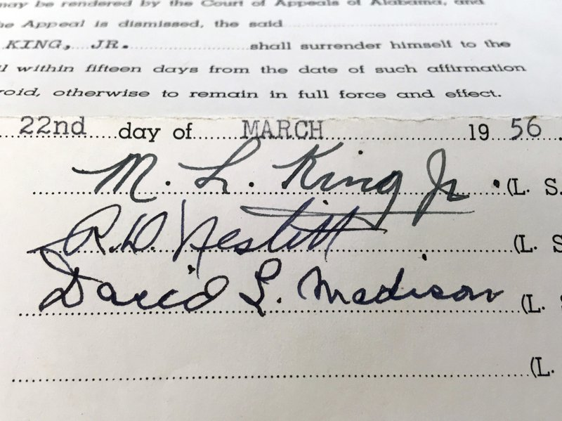 <p>This photo shows the signature of the Rev. Martin Luther King Jr. on a court document in the archive of Alabama State University in Montgomery, Ala. The school is preserving and digitizing historic court documents linked to the civil rights movement that were found in a box at the county courthouse. (Alabama State University via AP)</p>