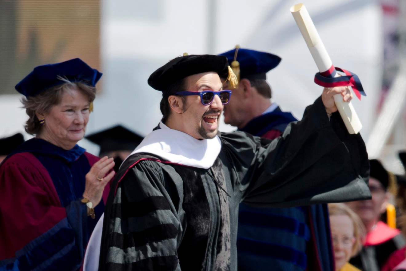 "FILE - In this May 16, 2016 file photo Lin-Manuel Miranda, creator of the Broadway musical ""Hamilton,"" reacts after receiving an honorary degree during the University of Pennsylvania commencement ceremony in Philadelphia.  Miranda, who was everywhere in popular culture this year, was named The Associated Press Entertainer of the Year, voted by members of the news cooperative. (AP Photo/Matt Rourke, File)"