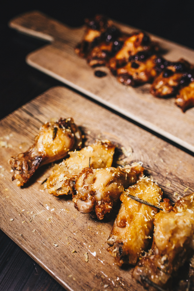"Drunkin' chicken wings come bone-in or boneless in a variety of liquor-inspired ""wing baths"" or sauces. / Image: Catherine Viox // Published: 3.7.19"