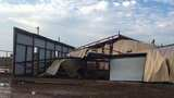 Photos: Storm destroys barn, causes major damage in Portales