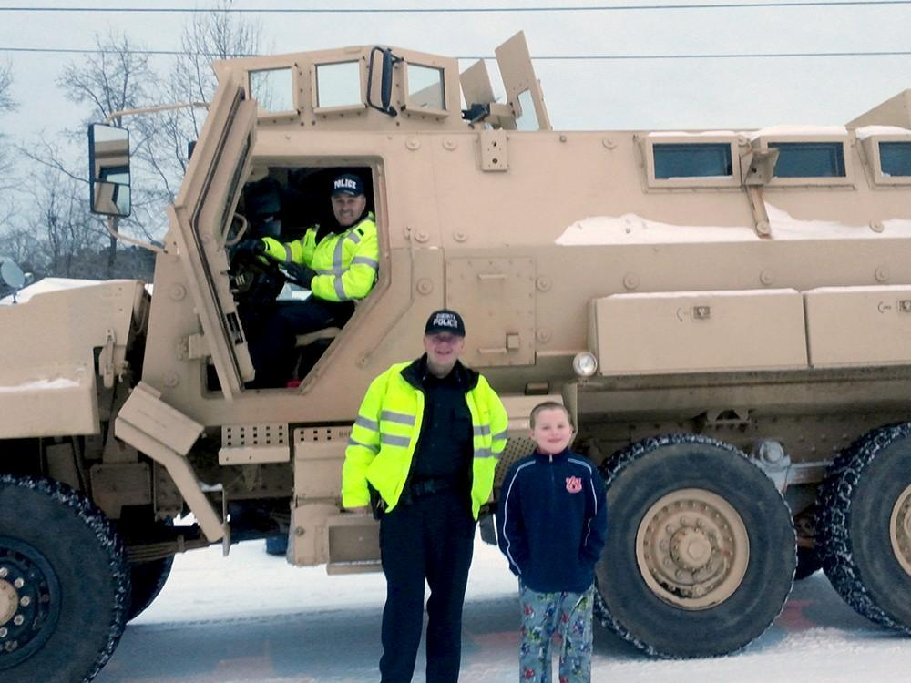 Oneonta police gave students a ride home from school after their bus became stuck in the snow, Tuesday, January 28, 2014.