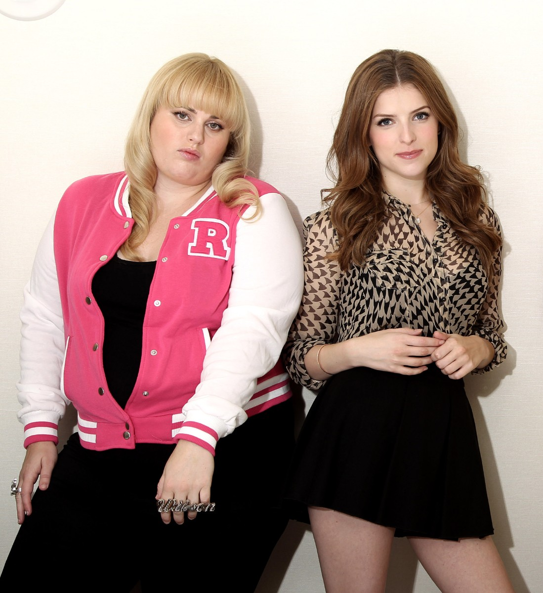 "FILE - This Sept. 21, 2012 file photo shows actors Rebel Wilson, left, and Anna Kendrick, from the film ""Pitch Perfect"", posing in West Hollywood, Calif. Wilson and Kendrick will return for a third film in the ""Pitch Perfect"" franchise. ?Pitch Perfect,? about a college all-girls a cappella singing group, has grown into a powerful box-office force. After the 2012 original made $115.4 million worldwide, ?Pitch Perfect 2? has taken in $259.7 million globally since opening May 15. (Photo by Matt Sayles/Invision/AP, file)"