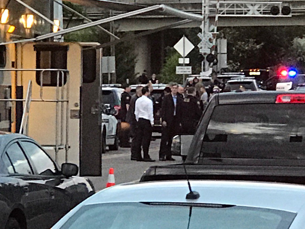 Portland Police Chief Mike Marshman (center looking toward camera) on the scene of a deadly officer-involved shooting near Southeast 92nd Avenue and Flavel Street on Wednesday night, May 10, 2017. Mayor Ted Wheeler is also at the scene. (Photo: Corry Young/KATU News)