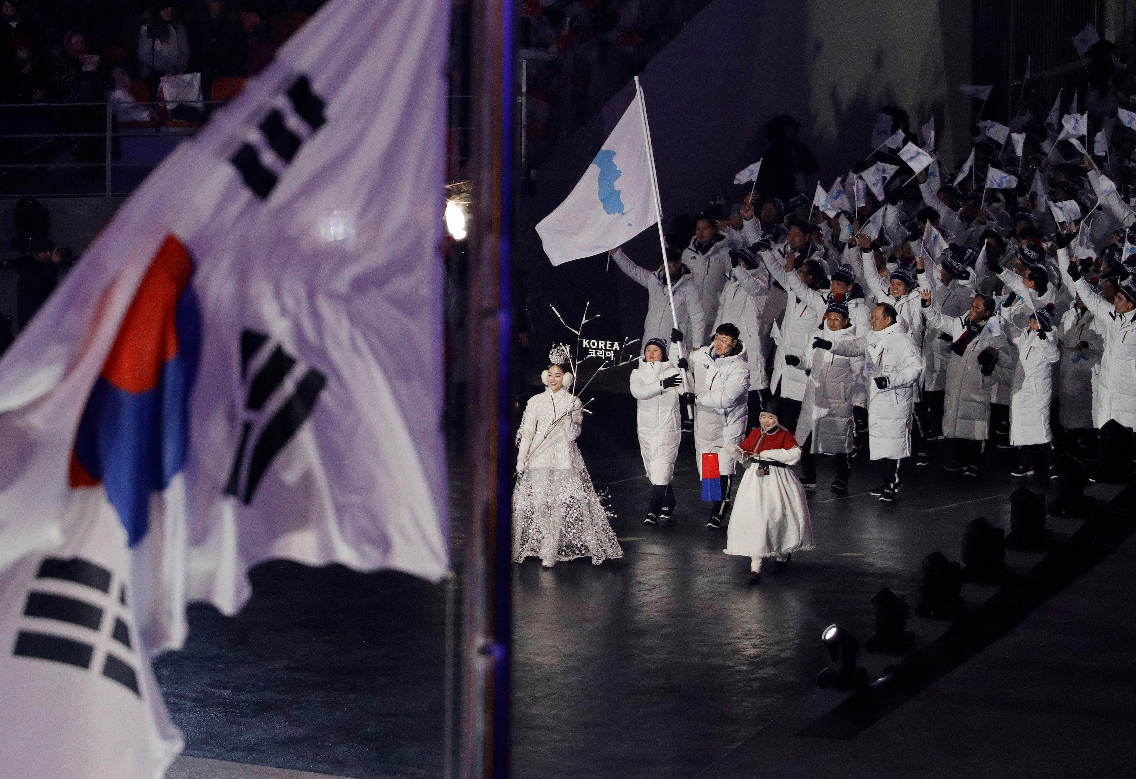 North Korean and South Korean athletes arrive during the opening ceremony of the 2018 Winter Olympics in Pyeongchang, South Korea, Friday, Feb. 9, 2018. (AP Photo/David J. Phillip,Pool)