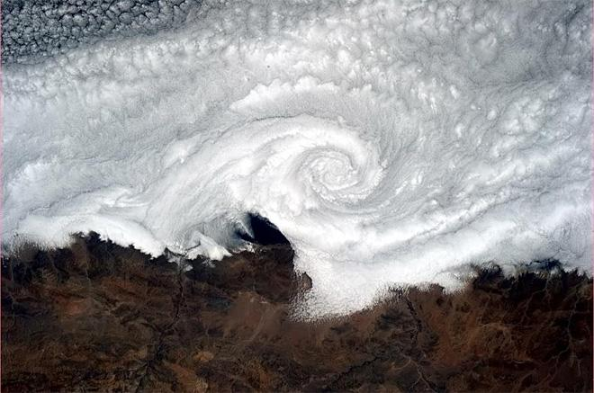 Cloud vortex spinning its wheels on the Chilean coast. (Photo & Caption: Chris Hadfield/NASA)