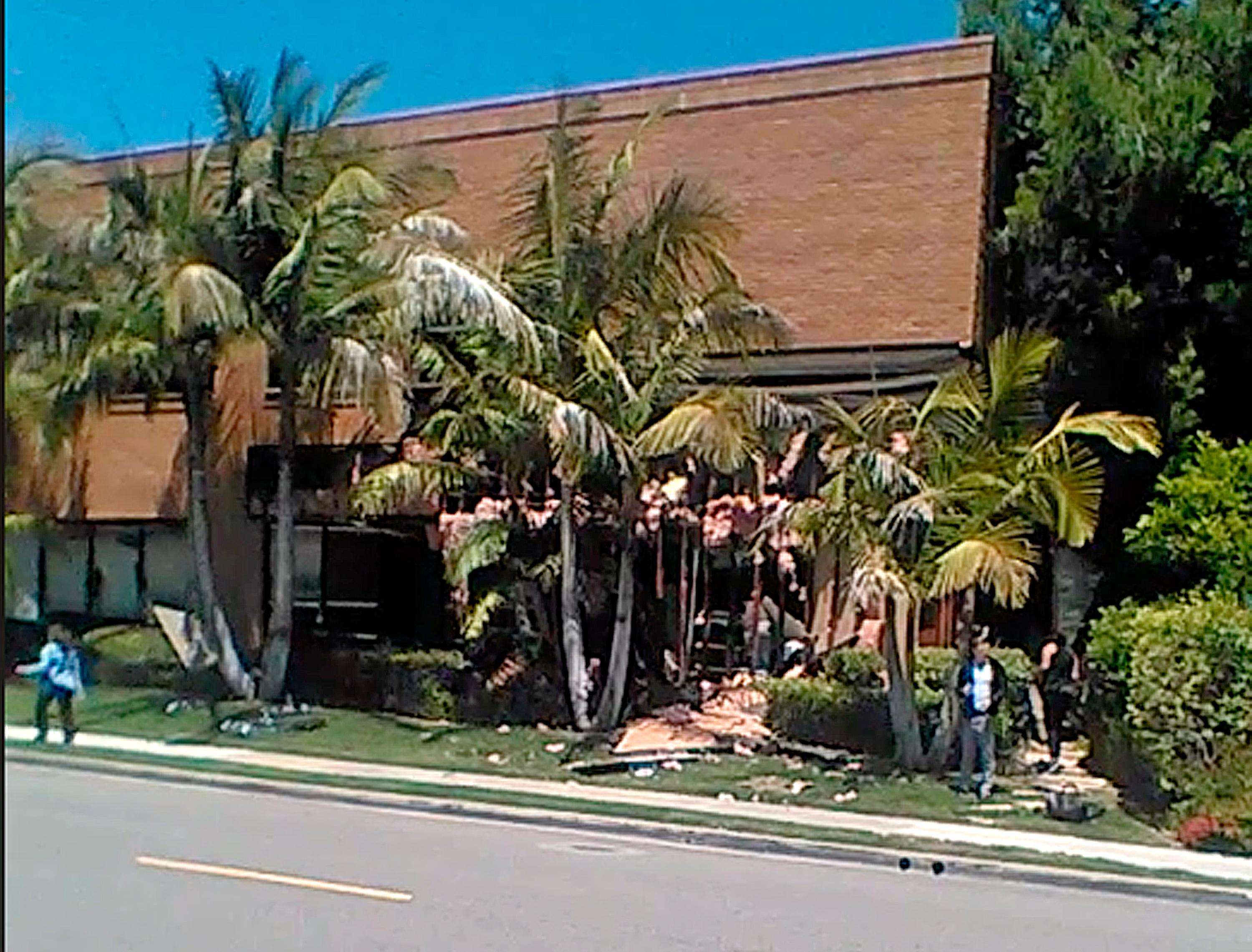 This image taken from cellphone video shows a building after a fatal explosion in Aliso Viejo, Calif., Tuesday, May 15, 2018. The cause of the blast is being investigated. (Raul Hernandez via AP)