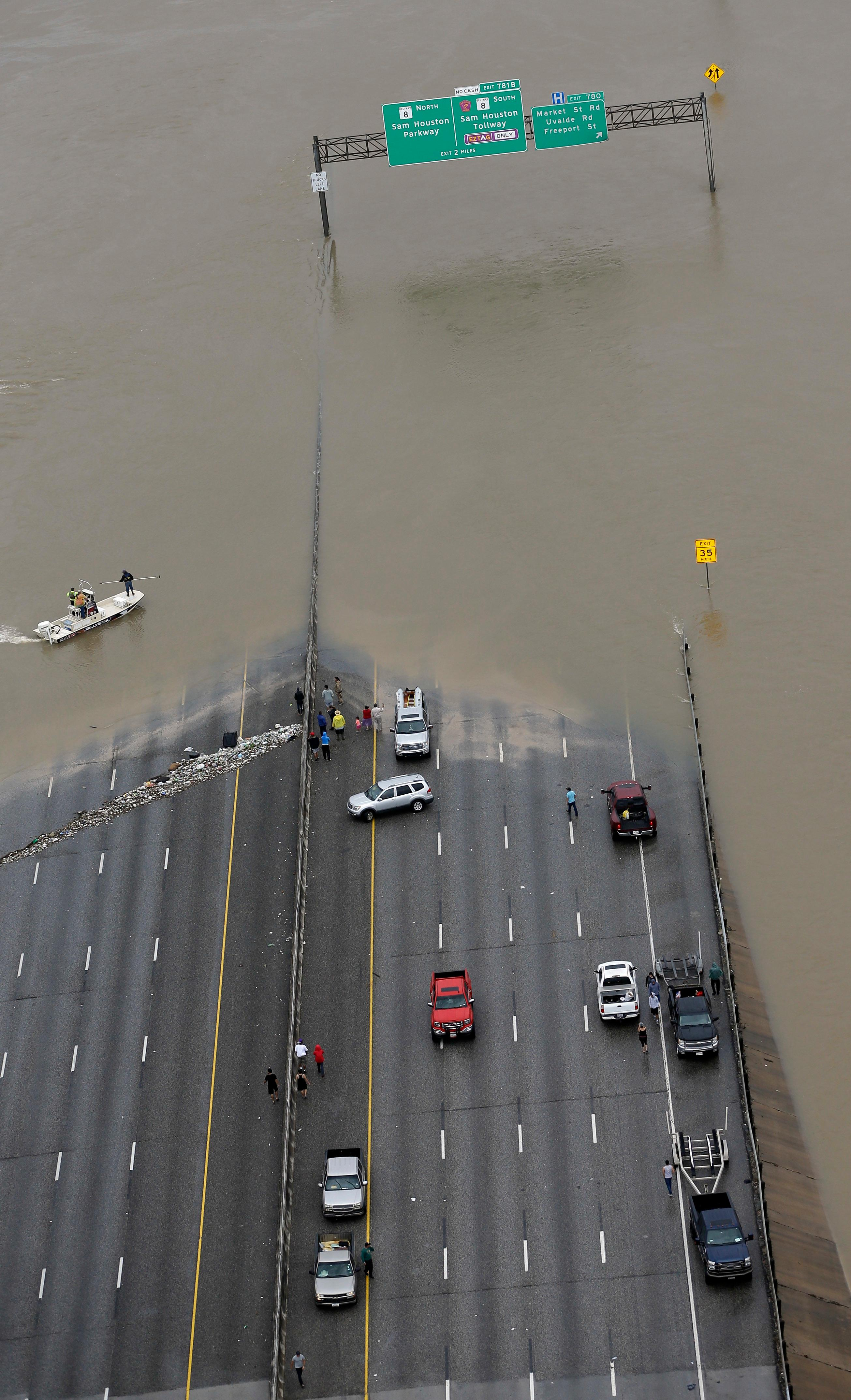 Interstate 10 is closed due to floodwaters from Tropical Storm Harvey Tuesday, Aug. 29, 2017, in Houston. (AP Photo/David J. Phillip)