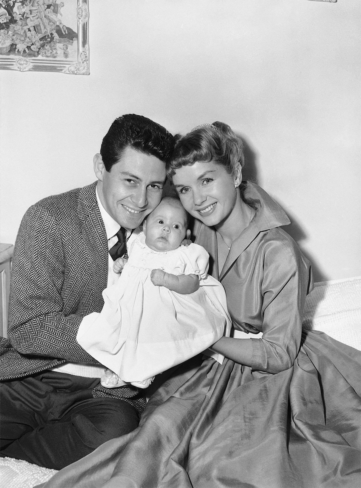 FILE - In this Jan. 2, 1957 file photo, Eddie Fisher and Debbie Reynolds hold their baby daughter, Carrie Frances Fisher, as the pose for a photo in the Hollywood area of Los Angeles. On Tuesday, Dec. 27, 2016, a publicist says Carrie Fisher has died at the age of 60. (AP Photo, File)