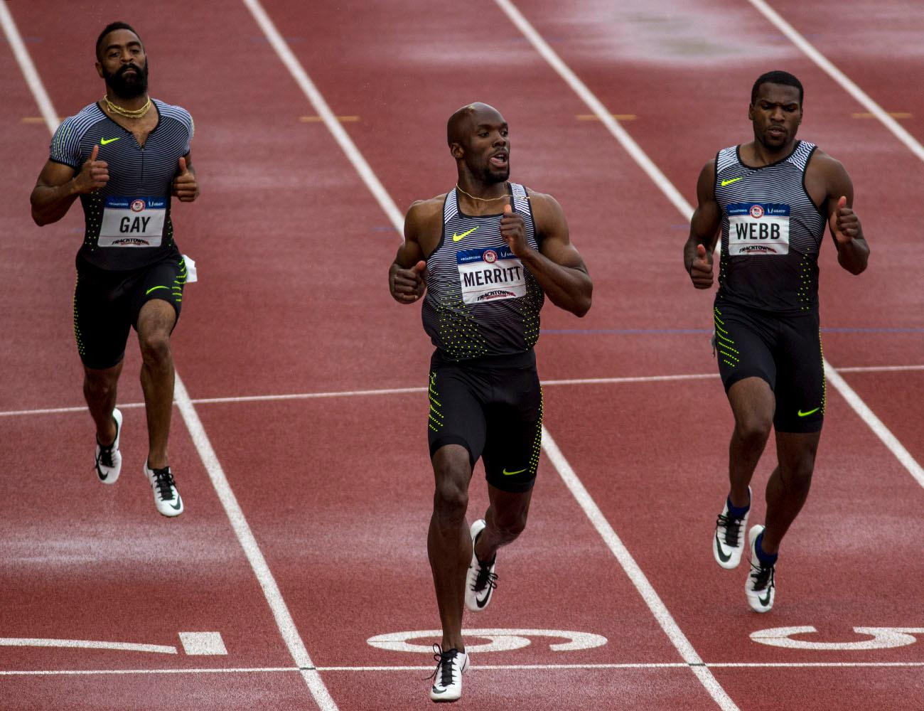 From left to right, Tyson Gay, LaShawn Merritt and Ameer Webb cross the finish line in the third heat of the Men�s 200m Dash semi-finals. Gay finished with a time of 20.16. Merritt finished with a time of 19.74 and Webb finished with a time of 19.97. They will all advance to the finals. Kristi Castlin, left, and Nia Ali, right, embrace after realizing they qualified for the Rio Olympics in the Women�s 100m Hurdle. Castlin finished second with a time of 12.50. Ali finished third with a time of 12:55. Day eight of the U.S. Olympic Track and Field Trials took place Friday at Hayward Field in Eugene, Ore. Events continue through July 10. (Photo by Amanda Butt)