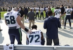 Seattle Seahawks' Michael Bennett remains seated on the bench during the national anthem before a game against the Green Bay Packers Sunday, Sept. 10, 2017, in Green Bay.