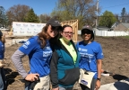 FOX 11's Emily Deem and Gabrielle Mays pose May 8, 2017, with Monique Perez, who will be moving into a Habitat for Humanity house in Green Bay with her husband and six children in June.