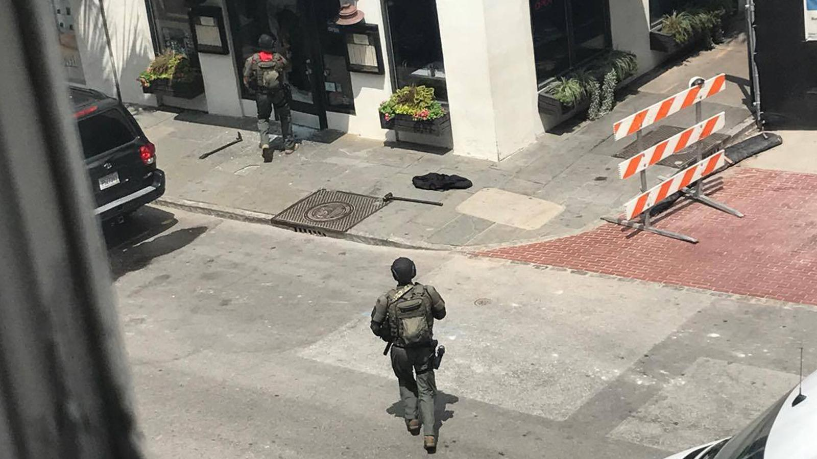 Law enforcement officers in body armor approach Virginia's on King restaurant. (Provided/Robbie Kimbrough)