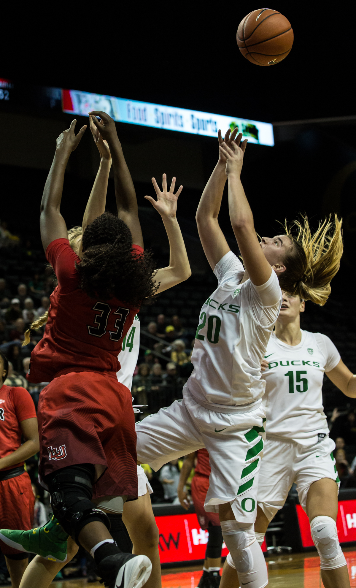 Oregon Ducks guard Sabrina Ionescu (#20) fights for the rebound with Cardinals point guard Kiandra Bowers (#33). The Oregon Ducks Women's basketball team won their season opener against the Lamar Cardinals 84-67.  Photo by Austin Hicks, Oregon News Lab