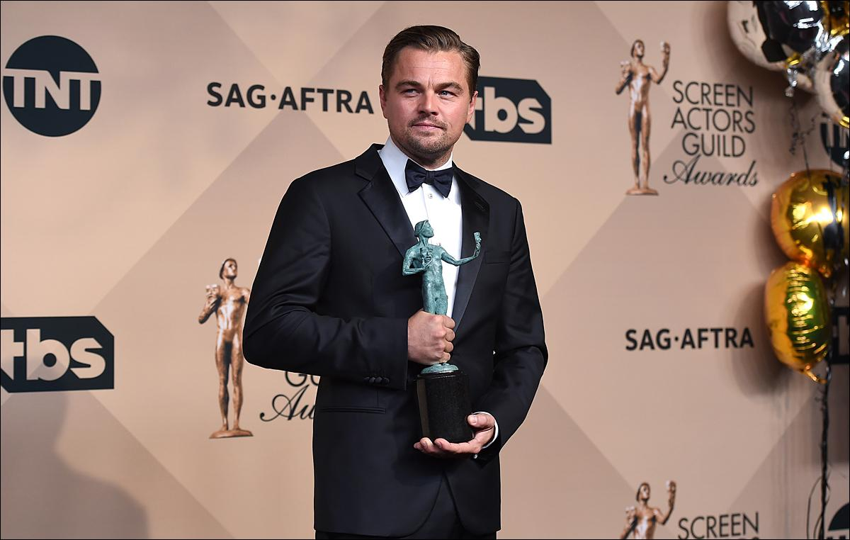 "Leonardo DiCaprio poses in the press room with the award for outstanding male actor in a leading role for ""The Revenant"" at the 22nd annual Screen Actors Guild Awards at the Shrine Auditorium & Expo Hall on Saturday, Jan. 30, 2016, in Los Angeles. (Photo by Jordan Strauss/Invision/AP)"