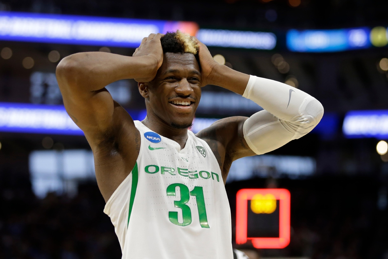 Oregon guard Dylan Ennis smiles after Oregon defeated Rhode Island 75-72 in a second-round game of the NCAA men's college basketball tournament in Sacramento, Calif., Sunday, March 19, 2017. (AP Photo/Rich Pedroncelli)