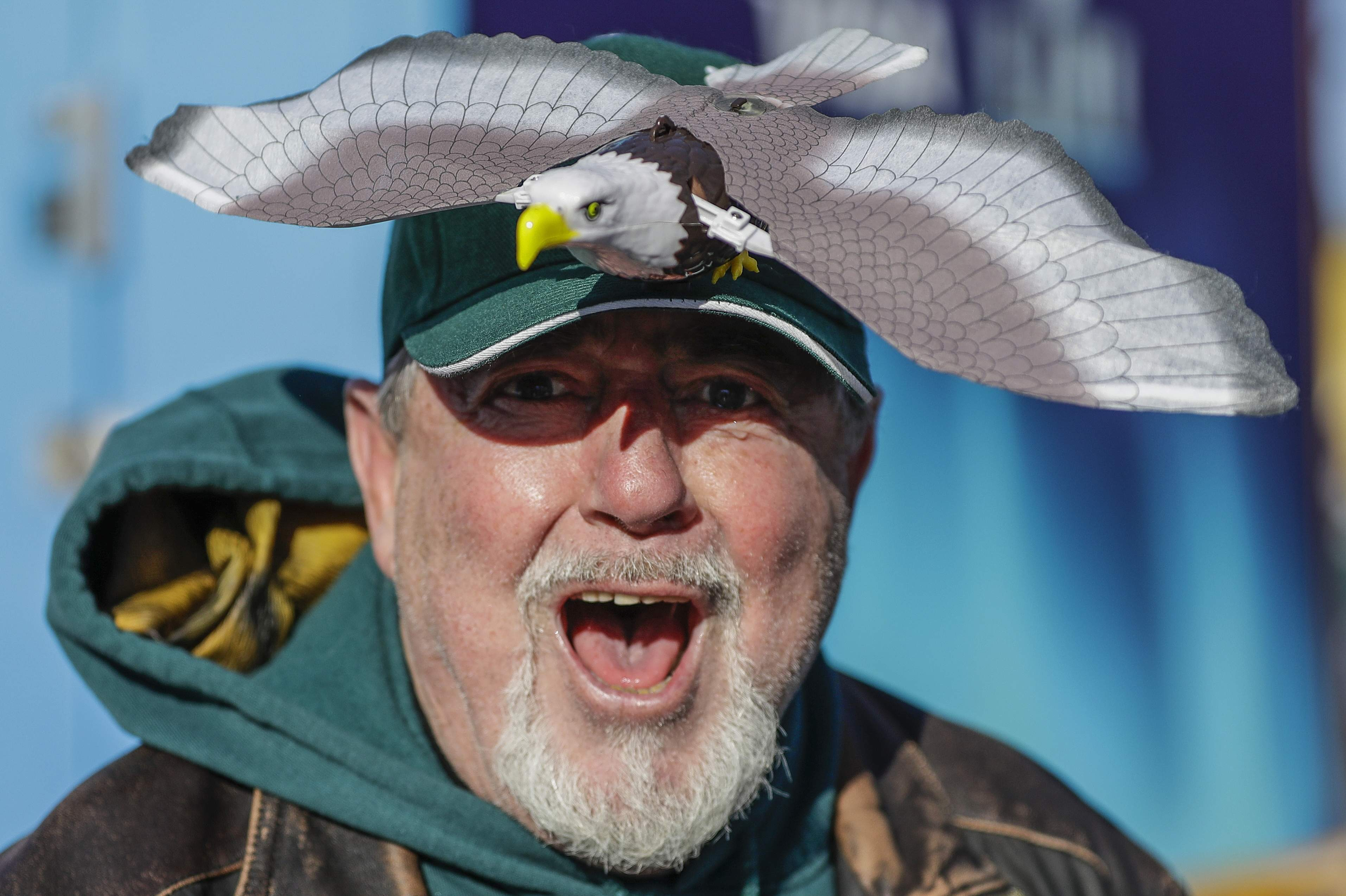 A Philadelphia Eagles fan cheers outside U.S. Bank Stadium before the NFL Super Bowl 52 football game against the New England Patriots Sunday, Feb. 4, 2018, in Minneapolis. (AP Photo/Mark Humphrey)