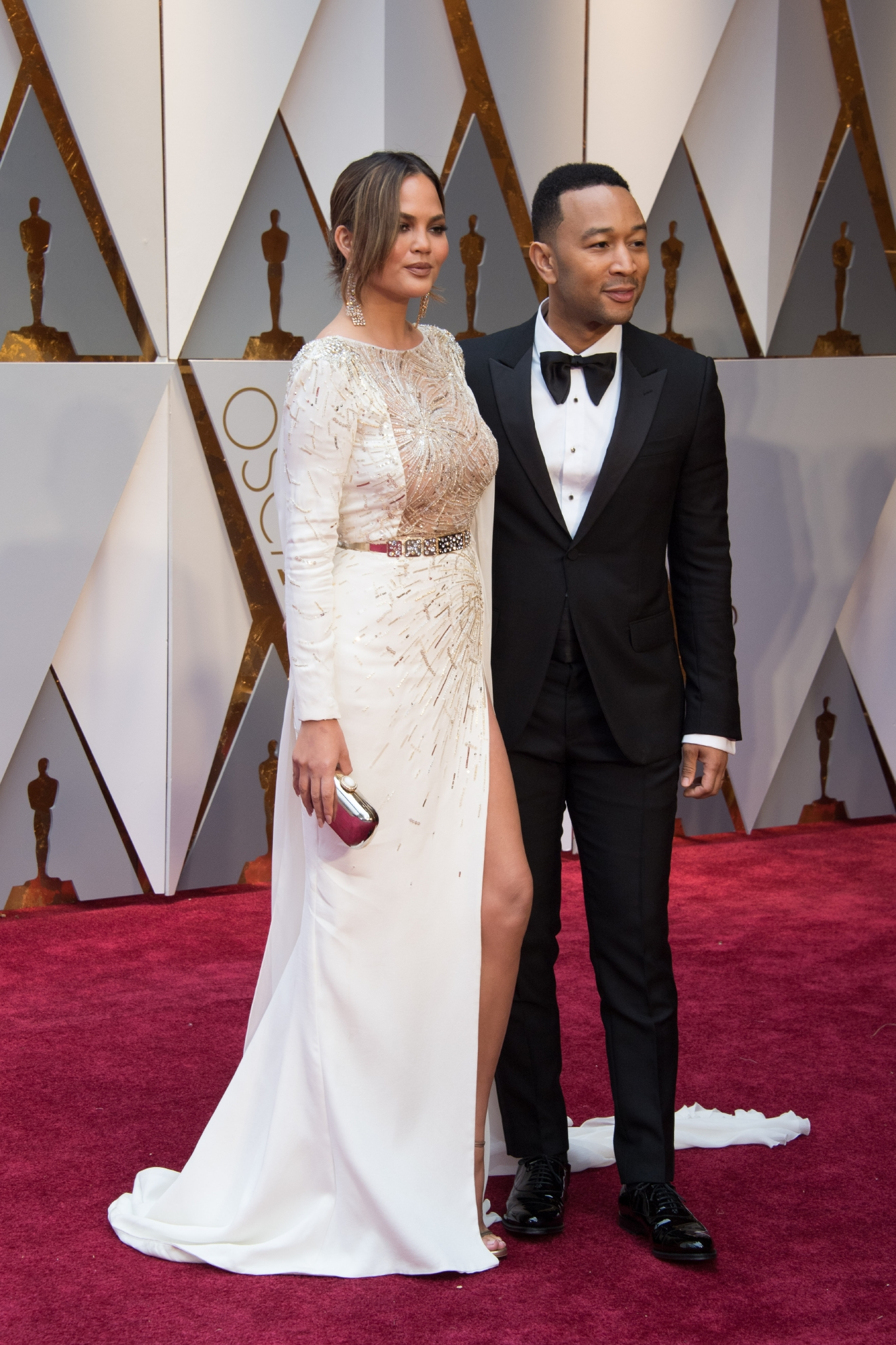 Chrissy Teigen and John Legend arrive at The 89th Oscars® at the Dolby® Theatre in Hollywood, CA on Sunday, February 26, 2017. (©A.M.P.A.S.)