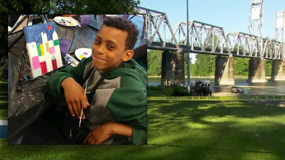 Photo of Nehemiah Wilson alongside the search scene on the Willamette River.jpg