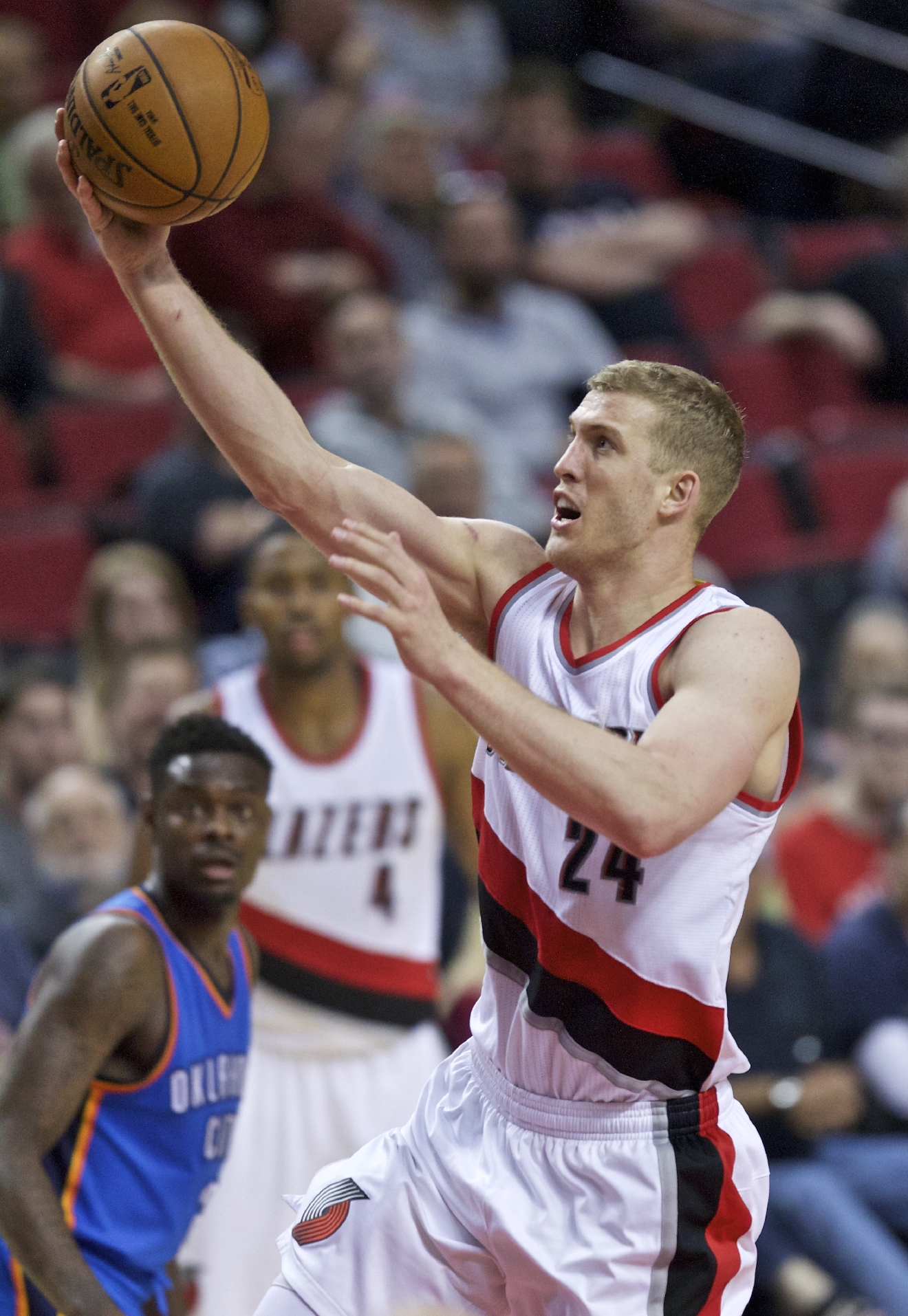 Portland Trail Blazers center Mason Plumlee shoots against the Oklahoma City Thunder during the second half of an NBA basketball game in Portland, Ore., Wednesday, April 6, 2016. (AP Photo/Craig Mitchelldyer)