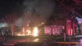 Crews battle massive fire as community clubhouse goes up in flames in Centreville