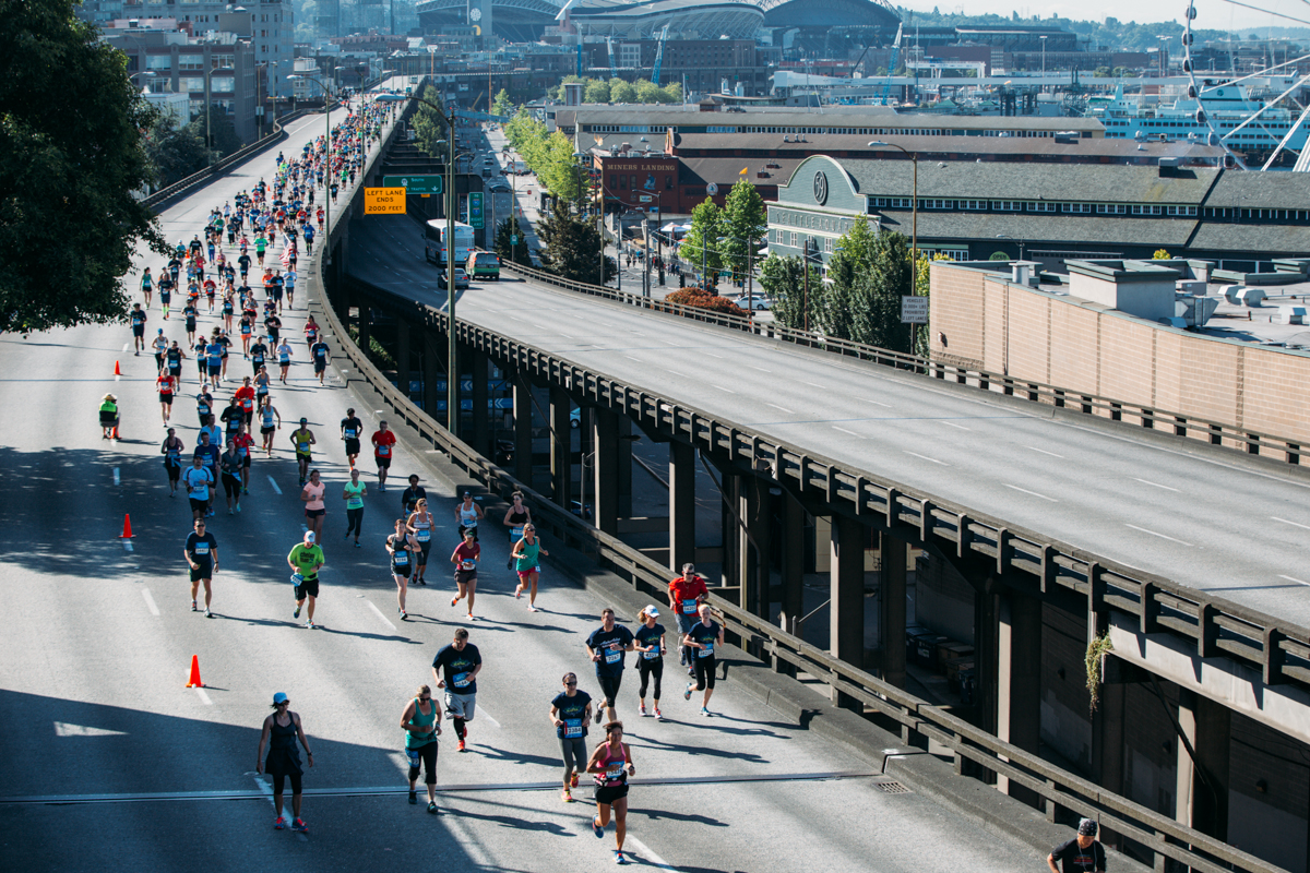 Tens of thousands of runners took to Seattle's streets to run in the 2014 Rock and Roll Marathon. Runners ran either a half or full marathon which sent them through downtown, Highway 99 or even the I-90 bridge depending on which distance they ran. June 21st 2014. (Joshua Lewis / Seattle Refined)