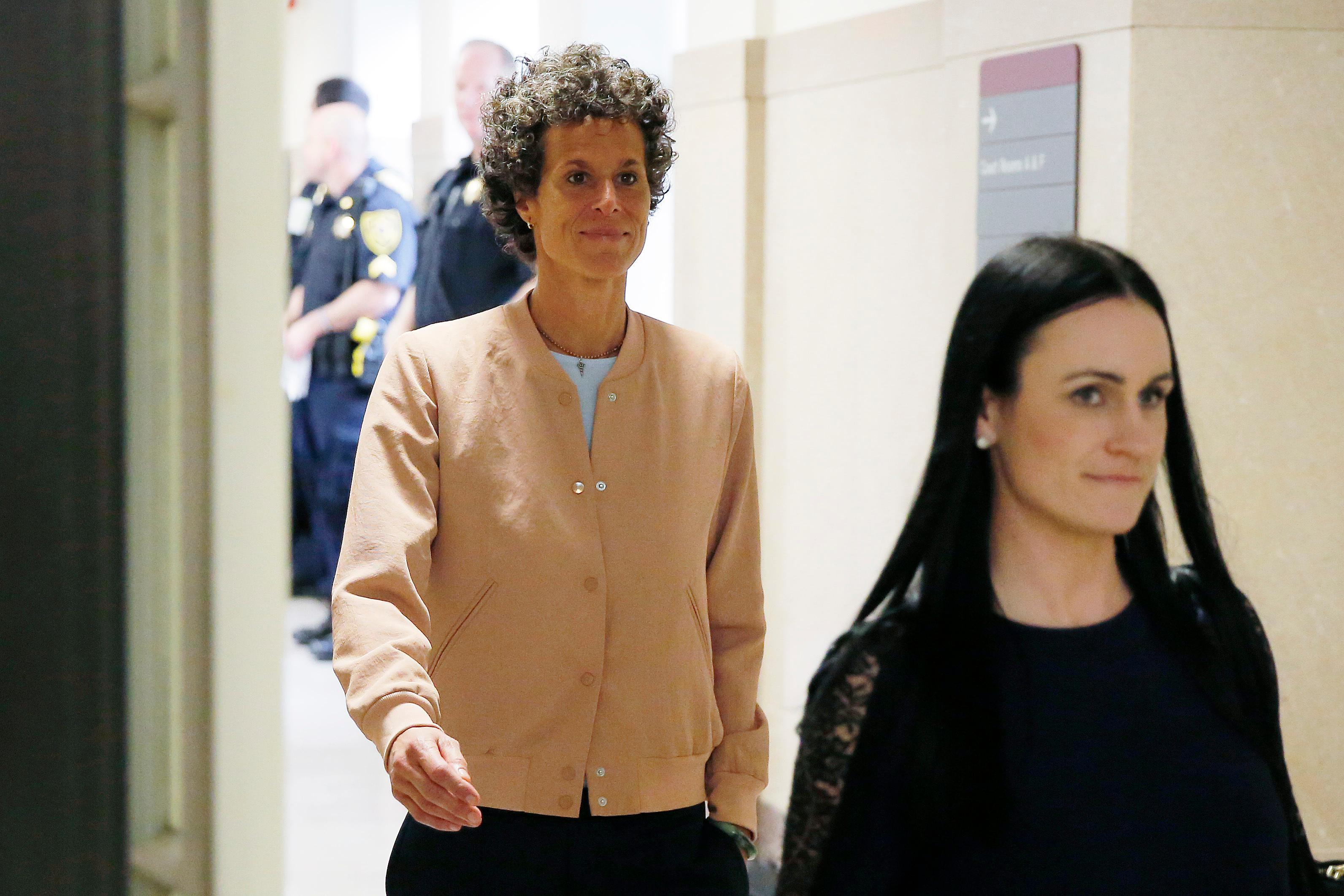 Andrea Constand, left, returns to the courtroom after a lunch break during Bill Cosby's sexual assault retrial at the Montgomery County Courthouse in Norristown, Pa., Monday, April 16, 2018. (Dominick Reuter/Pool Photo via AP)
