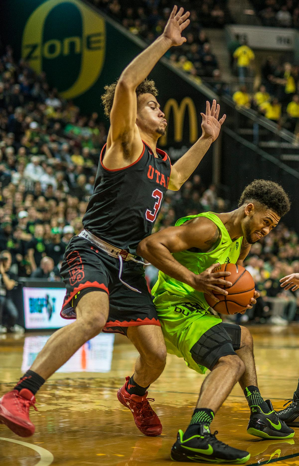 Oregon Ducks Tyler Dorsey (#5) attempts to make his way to the basket. The Oregon Ducks beat the Utah Utes 79-61 on Thursday night at Matthew Knight Arena. The victory was the 41st consecutive win for the Ducks at Matthew Knight. Dillon Brooks scored 20 points, Jordan Bell scored 17 points, and Tyler Dorsey ended the game with 16 points.  Photo by Rhianna Gelhart, Oregon News Lab
