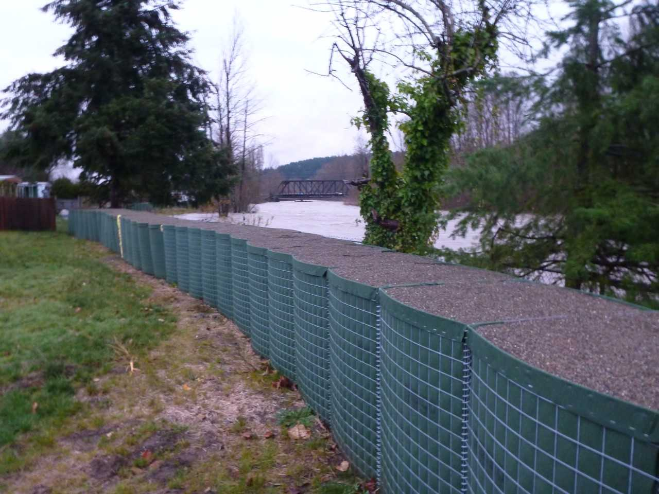 "King County places large ""HESCO"" barriers along the White River as part of their Countyline project to increase the capacity of the river (Photo via King County)"