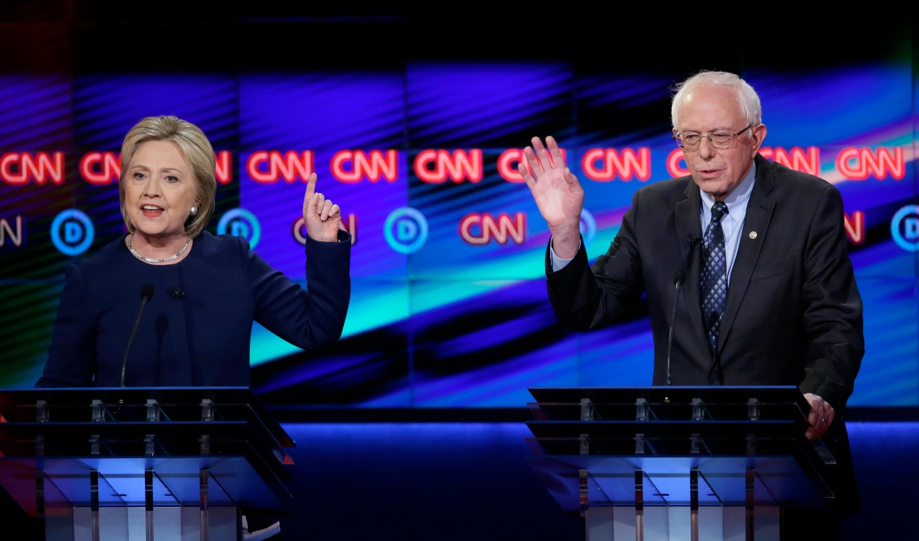 Democratic presidential candidate, Hillary Clinton argues a point as Sen. Bernie Sanders, I-Vt., reacts during a Democratic presidential primary debate at the University of Michigan-Flint, Sunday, March 6, 2016, in Flint, Mich. (AP Photo/Carlos Osorio)