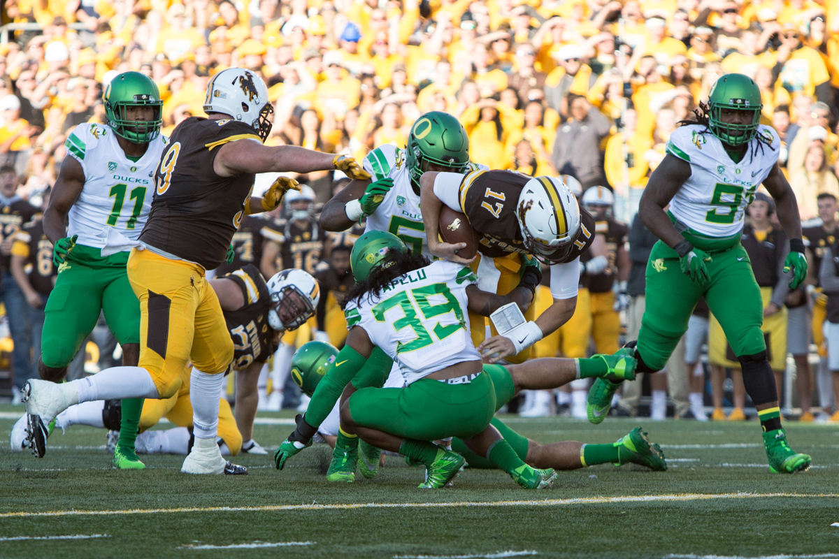 Wyoming quarterback Josh Allen (#17) dives over Oregon linebacker Kaulana Apelu (#39). The Oregon Ducks lead the Wyoming Cowboys 42 to 10 at the end of the first half on Saturday, September 16, 2017 in Laramie, Wyo. Photo by Austin Hicks, Oregon News Lab