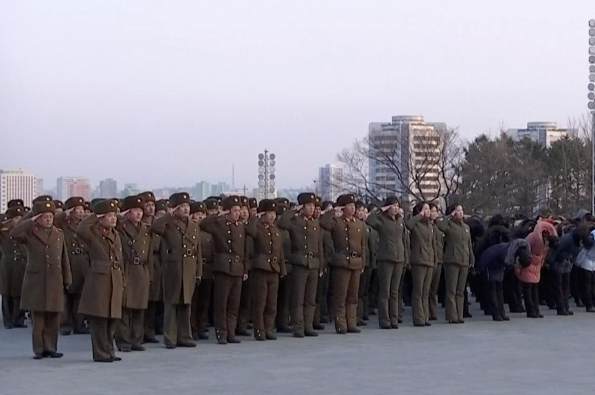 In this image taken from video footage, North Korean military personnel salute as they lay flowers in front of giant statues of Kim Il Sung and Kim Jong Il on Mansu Hill in central Pyongyang, Thursday, Feb. 8, 2018.  North Korea held a military parade and rally on Kim Il Sung Square on Thursday, just one day before South Korea holds the opening ceremony for the Pyeongchang Winter Olympics. (AP Photo)