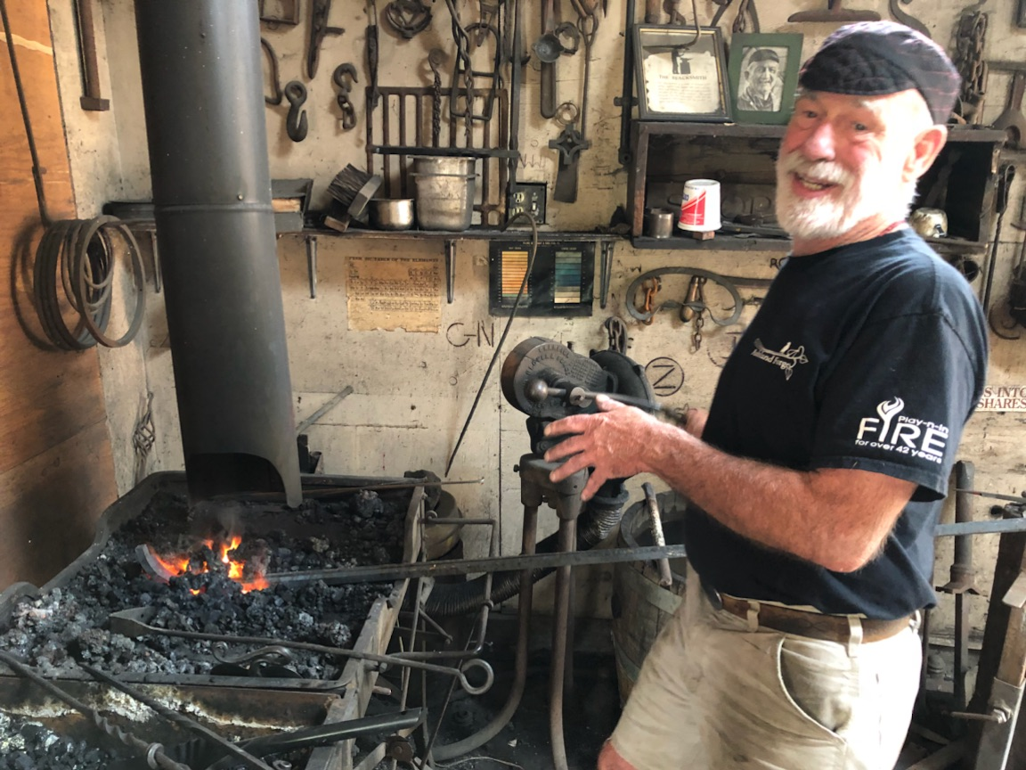 <p>Andy Atkinson / Mail Tribune<br>Dennis DeBey says blacksmithing, while hard work, requires more from the mind than the body.</p>