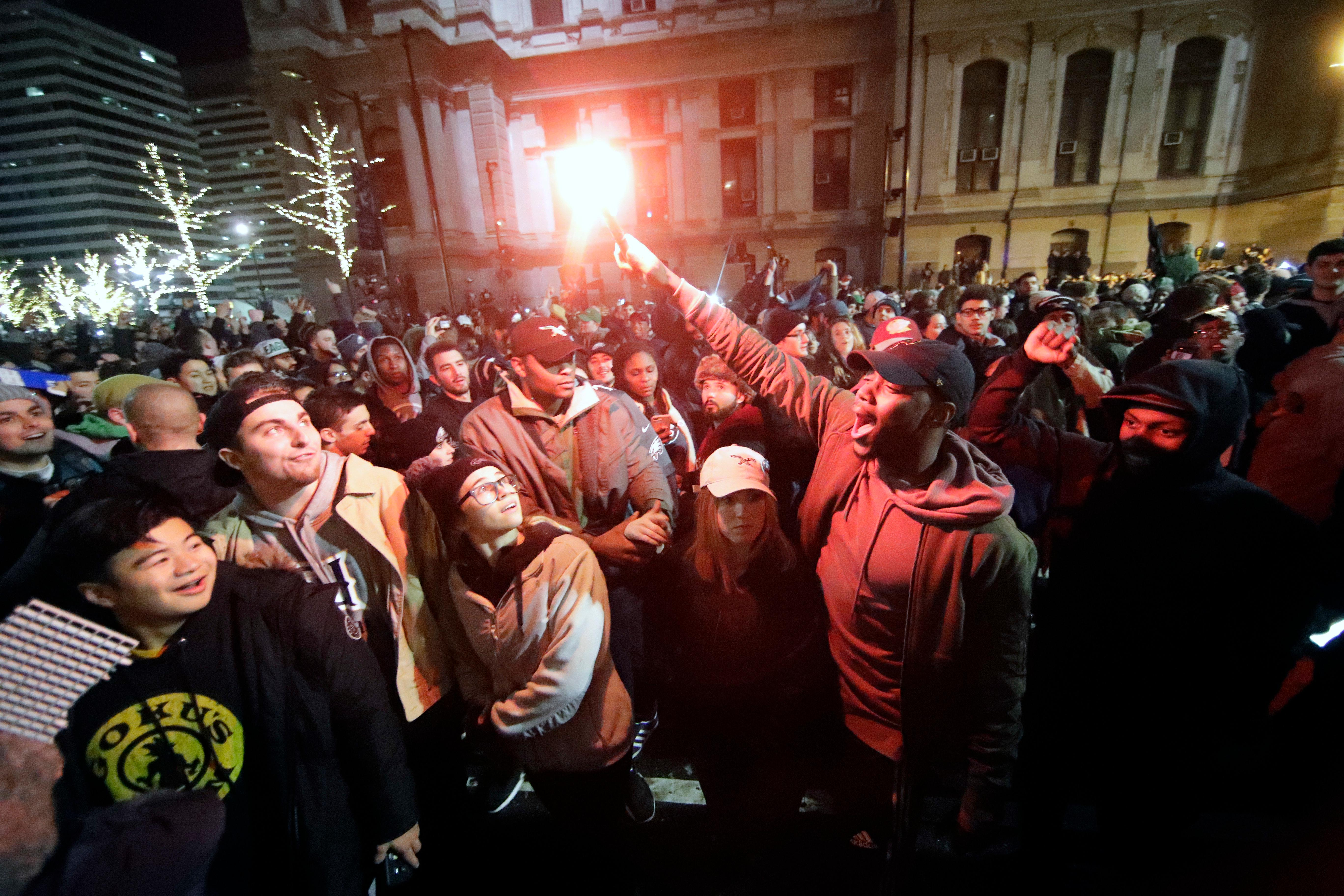 Philadelphia Eagles fans celebrate the team's victory in NFL Super Bowl 52 between the Philadelphia Eagles and the New England Patriots, Sunday Feb. 4, 2018, in downtown Philadelphia. (AP Photo/Matt Rourke)