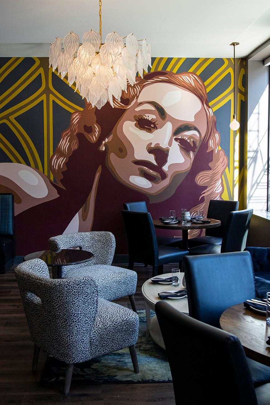 <p>The mural in 'The Living Room' dining room is named Rosie. / Image: Allison McAdams{&nbsp;}// Published: 11.14.19</p>