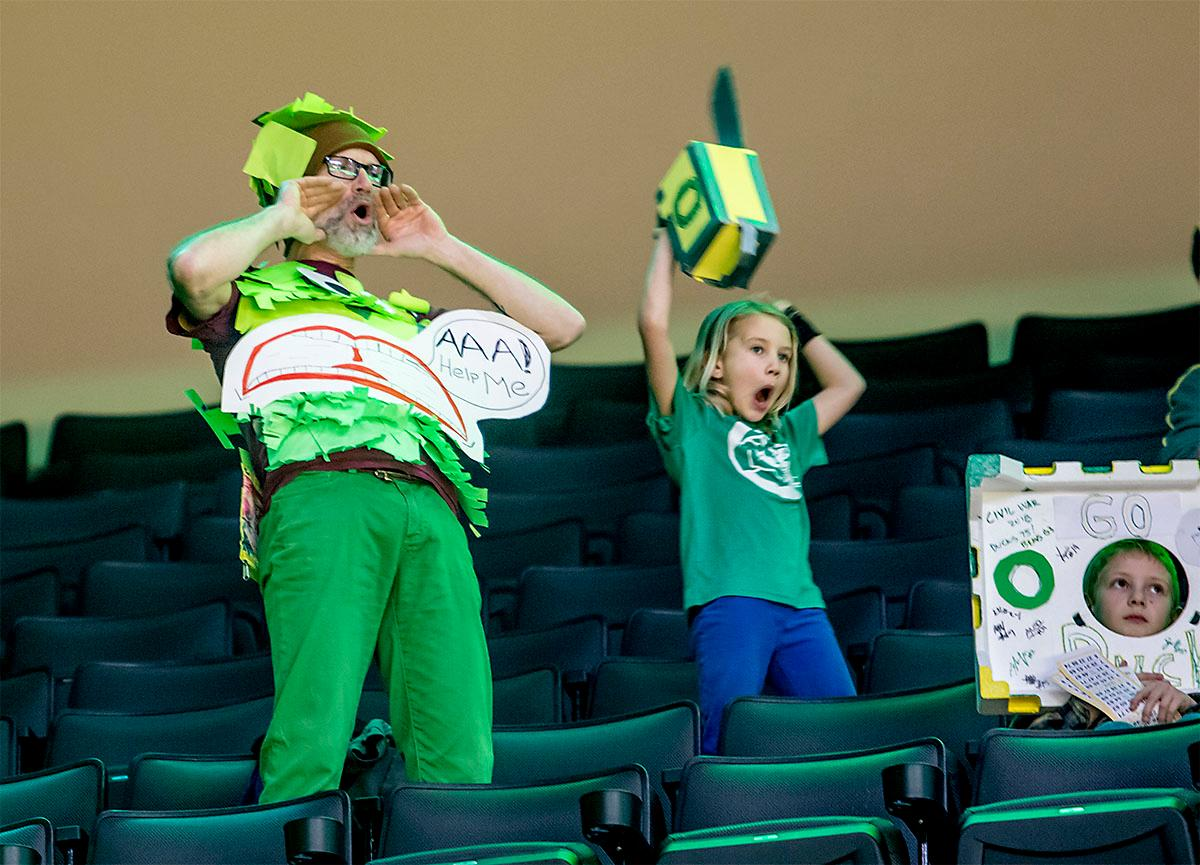 Fans cheer on the Ducks at Matthew Knight Arena. The Stanford Cardinal defeated the Oregon Ducks 78-65 on Sunday afternoon at Matthew Knight Arena. Stanford is now 10-2 in conference play and with this loss the Ducks drop to 10-2. Leading the Stanford Cardinal was Brittany McPhee with 33 points, Alanna Smith with 14 points, and Kiana Williams with 14 points. For the Ducks Sabrina Ionescu led with 22 points, Ruthy Hebard added 16 points, and Satou Sabally put in 14 points. Photo by August Frank, Oregon News Lab