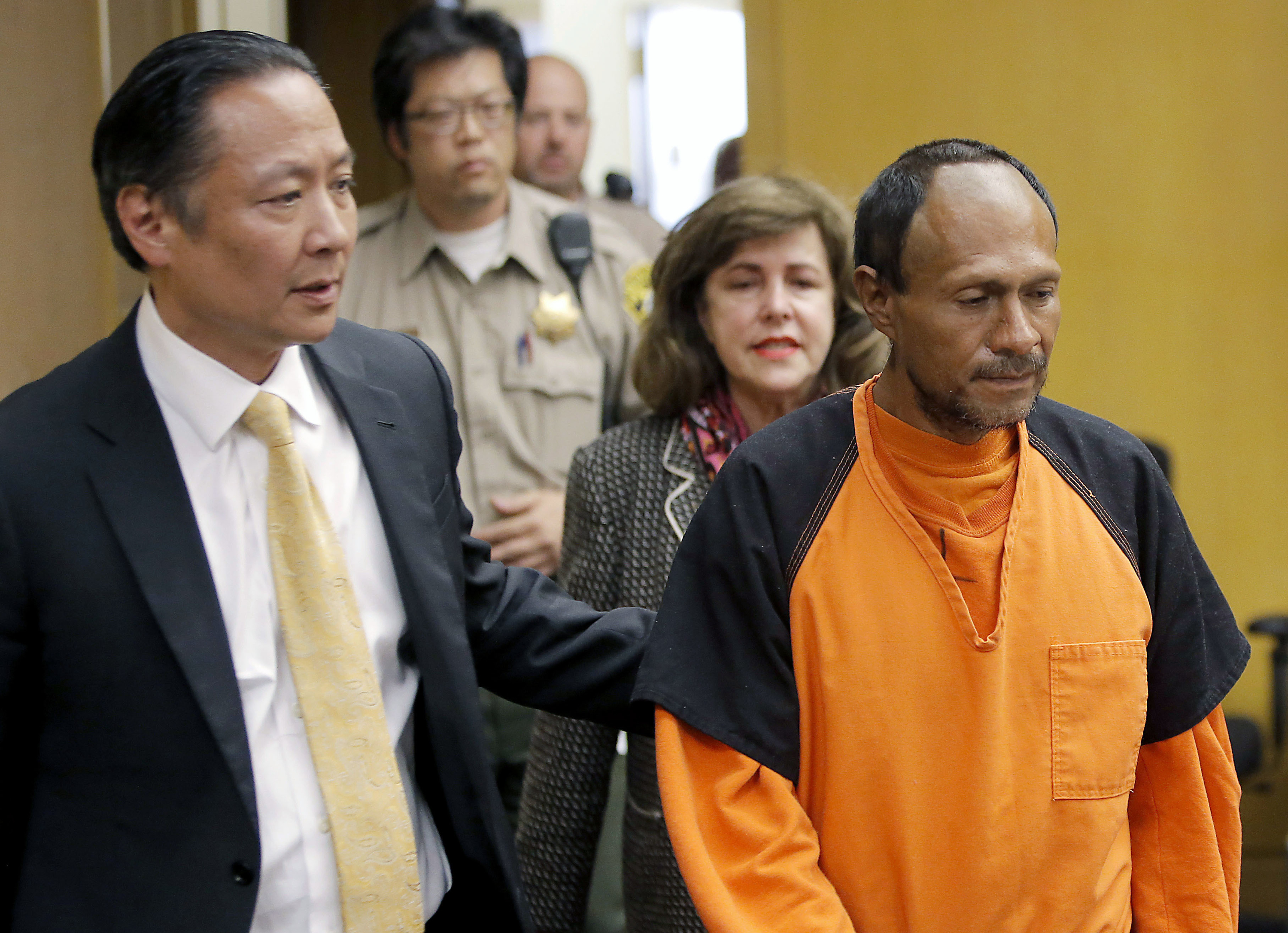 FILE - In this July 7, 2015 file photo, Jose Ines Garcia Zarate, right, is led into the courtroom by San Francisco Public Defender Jeff Adachi, left, and Assistant District Attorney Diana Garciaor, center, for his arraignment at the Hall of Justice in San Francisco.{&amp;nbsp;} (Michael Macor/San Francisco Chronicle via AP, Pool, File)<p></p>