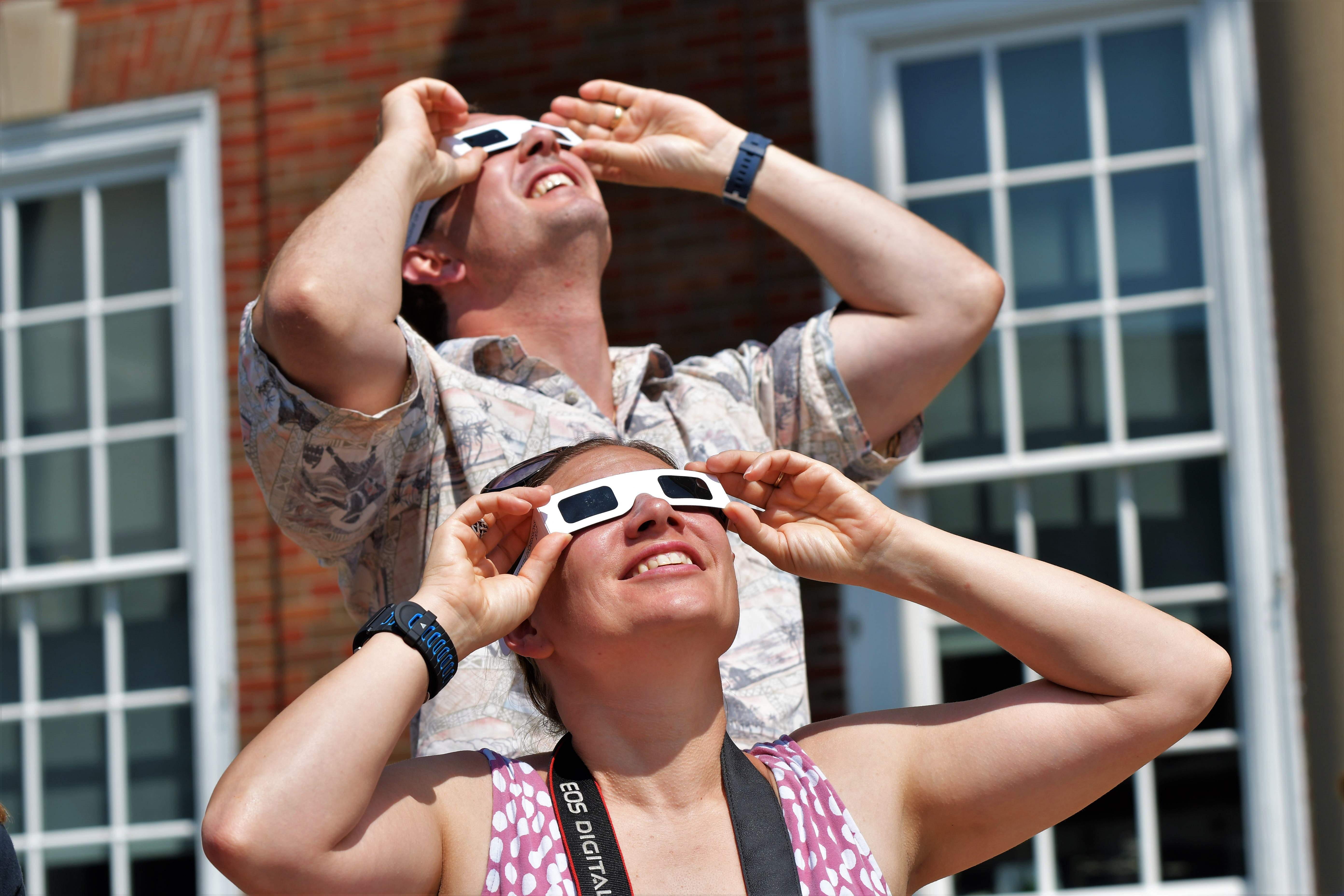 Spectators at the Independence Square view the eclipse at about 80 percent of totality. [David M. Rainey/Special to The Examiner]