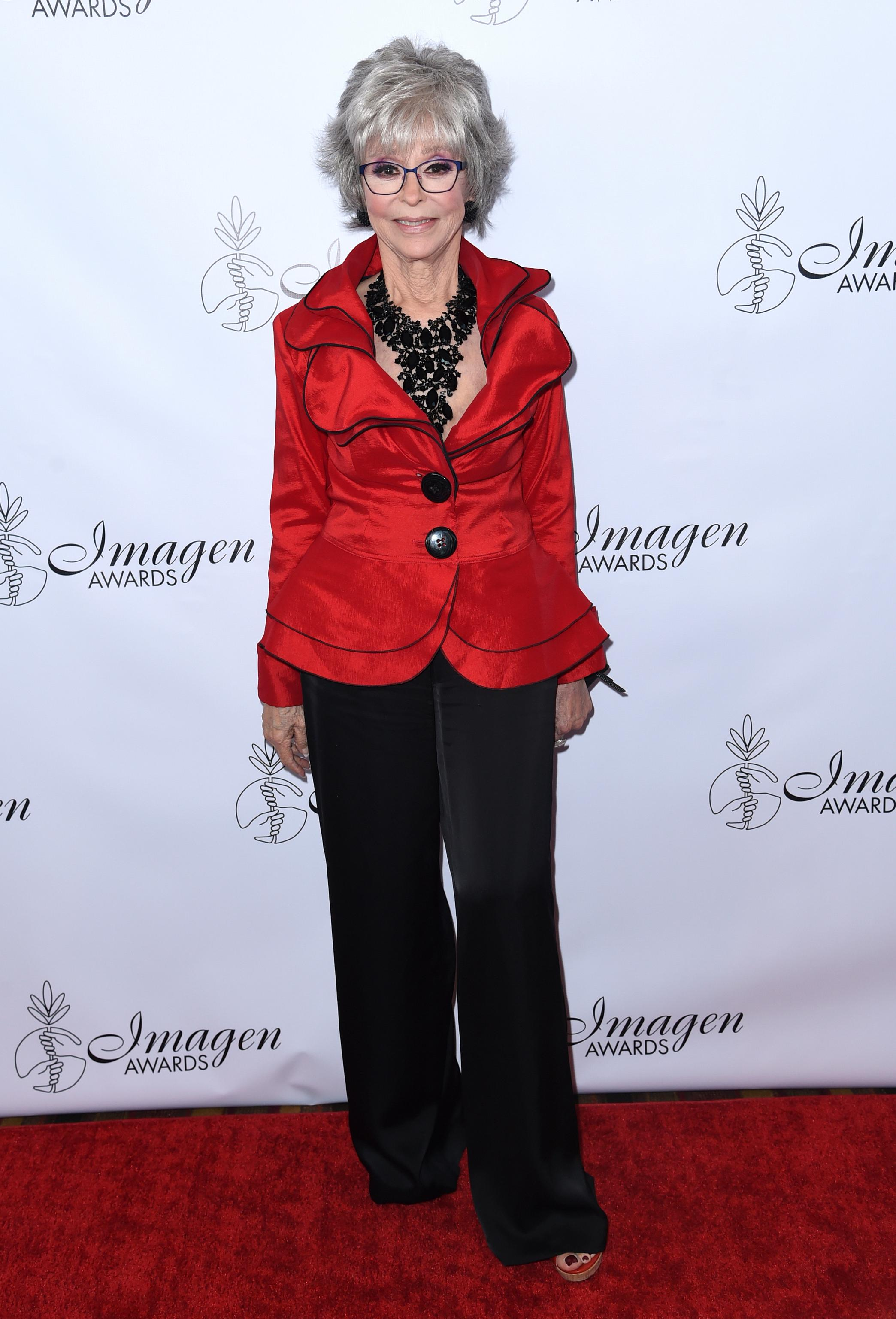 FILE - In this Aug. 25, 2018, file photo, Rita Moreno arrives at the 33rd annual Imagen Awards in Los Angeles. PBS announced Monday, July 29, 2019,.(Photo by Richard Shotwell/Invision/AP, File)