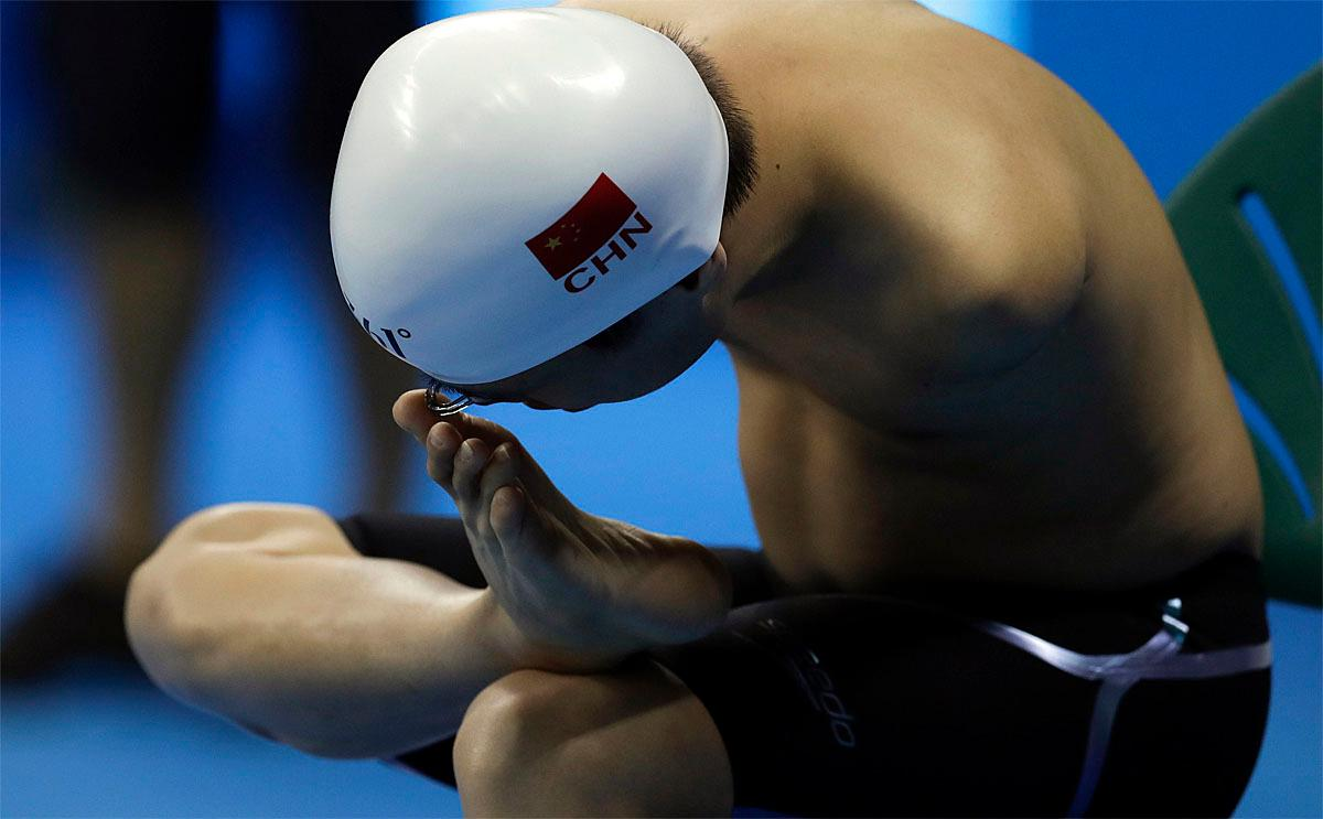 Luo Fangyu of China adjusts his nose clip before competing in the men's 100-meter backstroke S6 swimming event at the Paralympic Games in Rio de Janeiro, Brazil, Thursday Sept. 8, 2016. (AP Photo/Leo Correa)