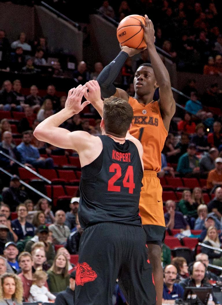 Texas guard Andrew Jones, right, shoots over Gonzaga forward Corey Kispert during the second half of an NCAA college basketball game in the Phil Knight Invitational tournament in Portland, Ore., Sunday, Nov. 26, 2017. (AP Photo/Craig Mitchelldyer)