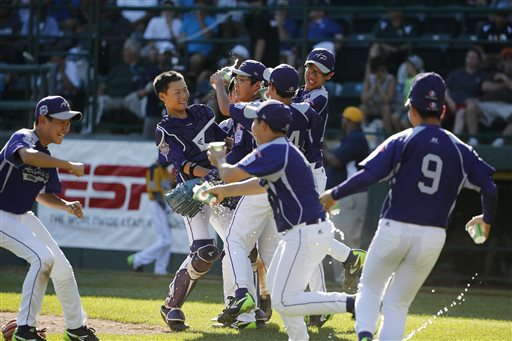 South Korea celebrates after getting the final out of an 8-4 win in the Little League World Series championship baseball game against Chicago.
