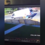 Delivery woman throws package over a fence