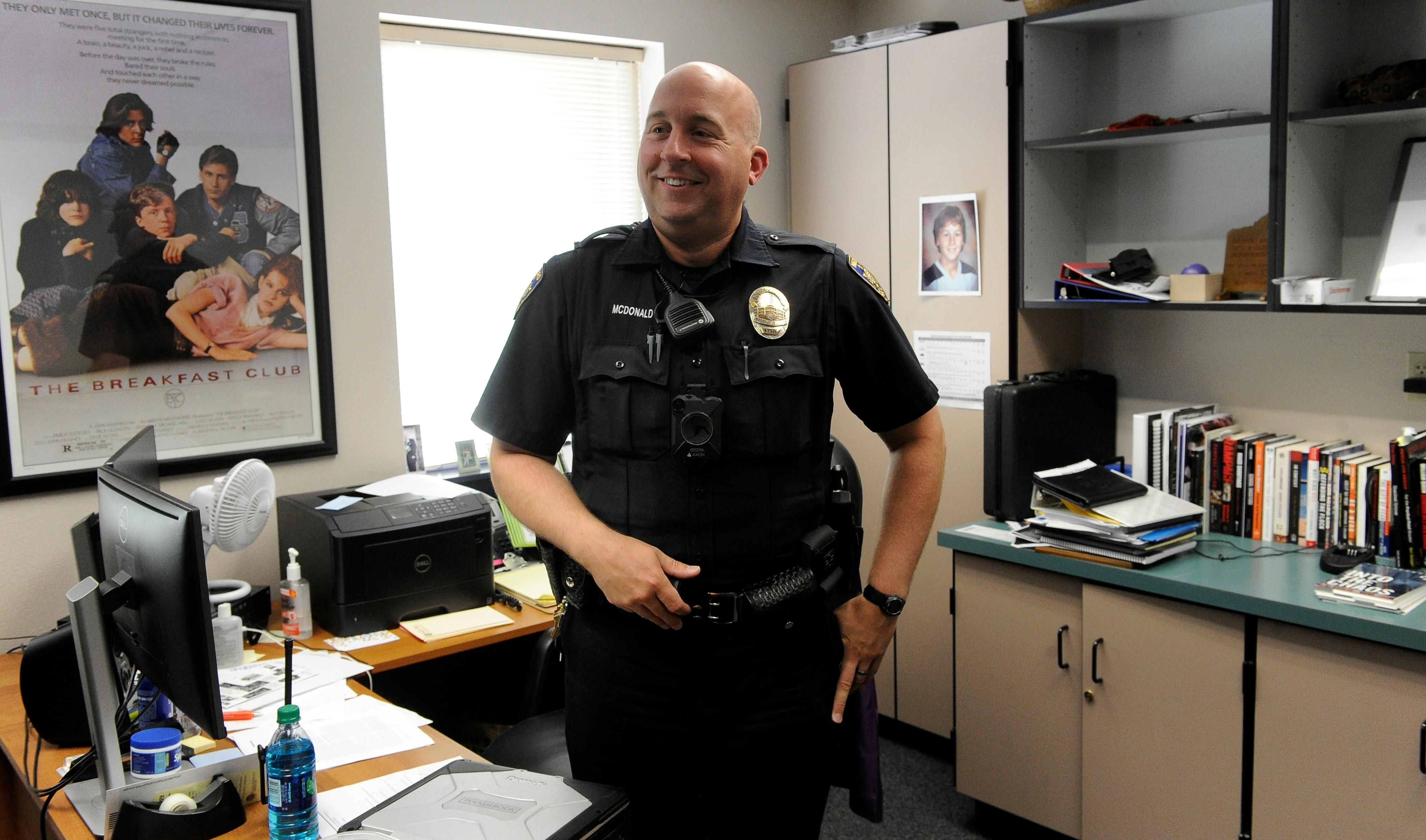 Andy Atkinson / Mail Tribune- Medford School Resource Officer Ian McDonald in his office at Hedrick Middle School.