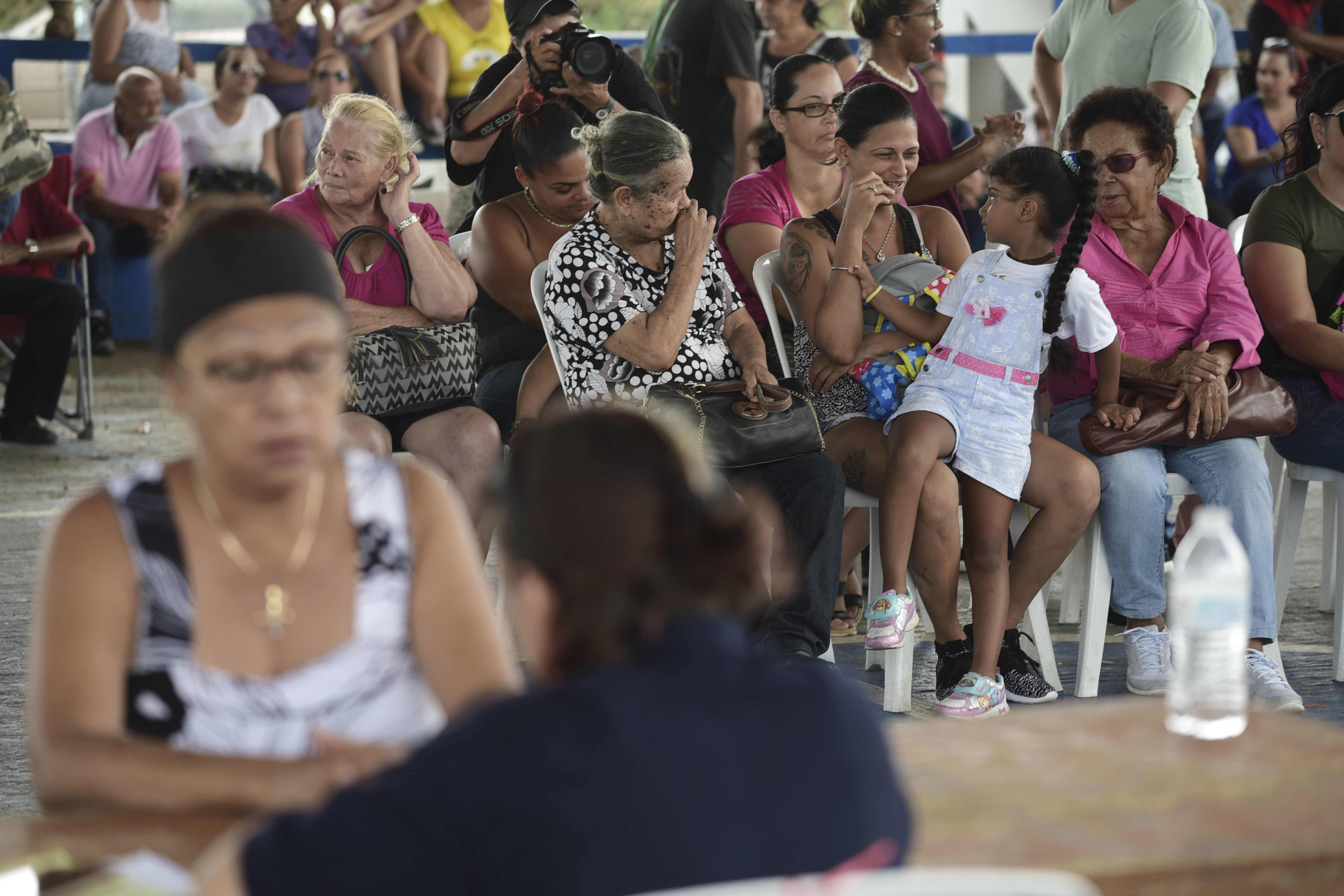 People wait at the Jose de Diego Elementary School to file FEMA forms for federal aid in the aftermath of Hurricane Maria in Las Piedras, Puerto Rico, Monday, Oct. 2, 2017.  Power is still cut off on most of the island, schools and many businesses are closed and much of the countryside is struggling to find fresh water and food. (AP Photo/Carlos Giusti)